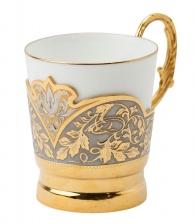 фарфоровая чашка в золотом подстаканнике